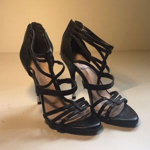 Strappy high heels.
